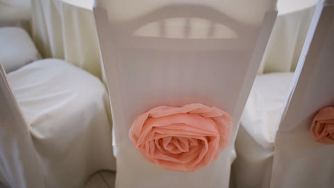 White chair with peach color decorated rose, empty wedding celebration venue Live Action