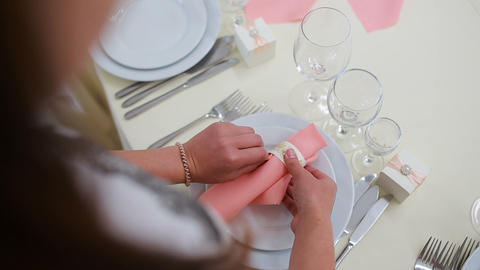 Female hands folding napkins. waiter folding napkin artistically with a flowers Footage