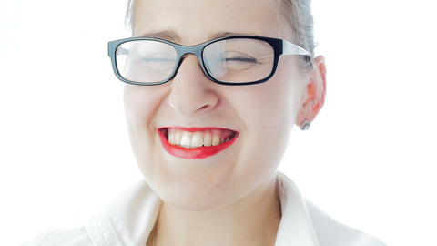 Slow motion video of happy laughing woman with red lipstick wearing eyeglasses Footage