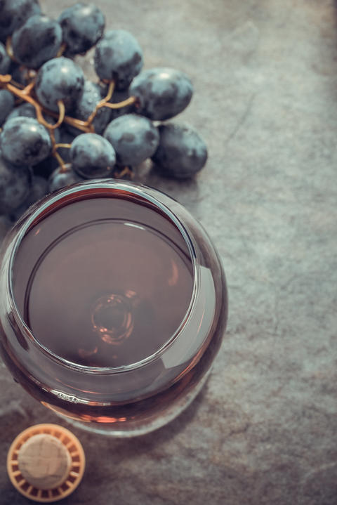 cognac glass and grapes Photo