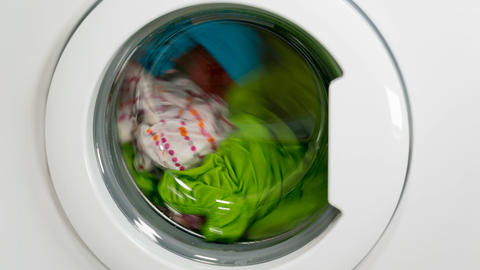 Washing machine is washing clothes Live Action