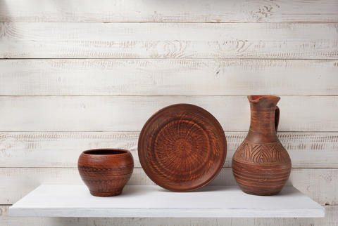 clay jug and plate at shelf Photo
