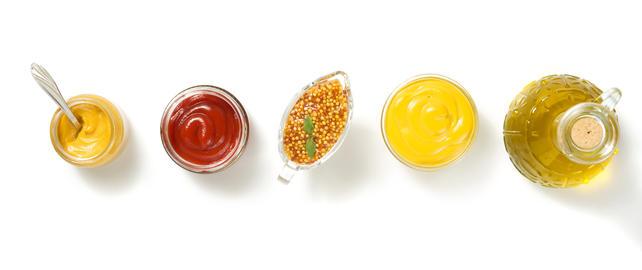 tomato sauce and mustard on white Photo
