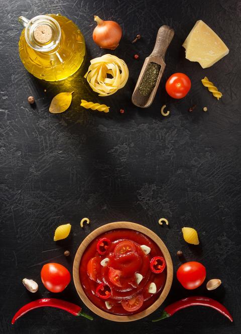tomato sauce in bowl on black background Photo