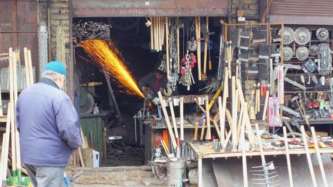 SAFRANBOLU, TURKEY - MAY 2015: Blacksmith worker at workshop Footage