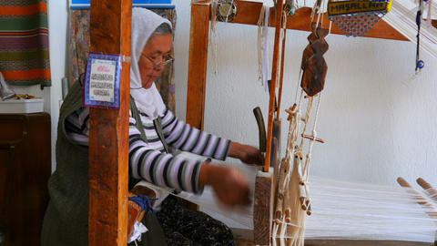 FETHIYE, TURKEY- MAY 2015: turkish woman weaving loom machine Footage