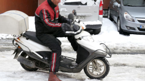 ISTANBUL, TURKEY - FEBRUARY 2015: scooter courier riding, snowy streets Footage