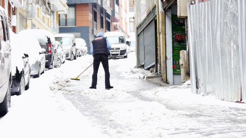 ISTANBUL, TURKEY - FEBRUARY 2015: manually cleaning streets from snow Footage
