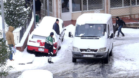 ISTANBUL, TURKEY - FEBRUARY 2015: Car stuck, spinning, snowy streets Footage
