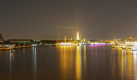 view of Wat Arun at night, beautiful lights and water traffic フォト