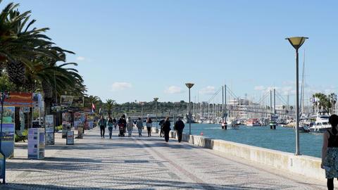 Avenida dos Descobrimentos with tourists walking GIF