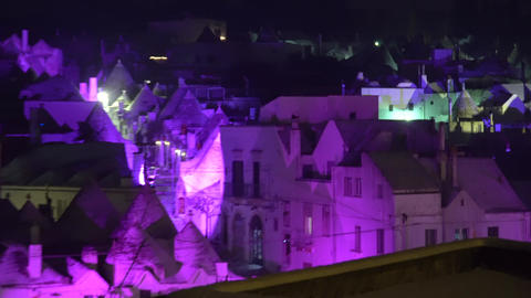 Night shot of trulli in Alberobello town Italy during Christmas Footage