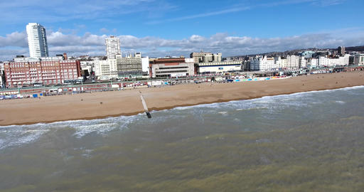 Aerial shot of Brighton UK seafront: revealing beach, buildings, cinema and pier Footage