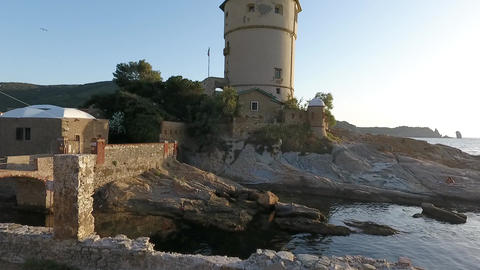 Aerial view of Giglio Island in Tuscany Italy, revealing light house and coast Footage