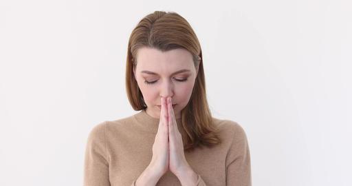 closeup young beautiful woman begs, pray Footage