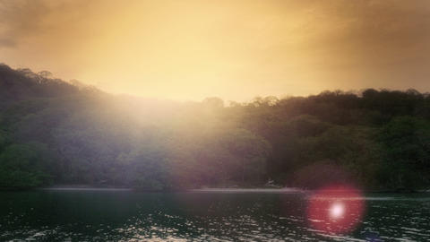 Sun setting behind an island beach Footage