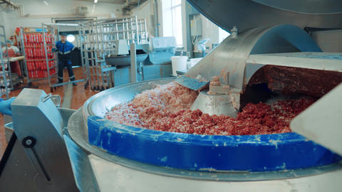 Meat mincing machine grinding meat in meat processing plant Live Action