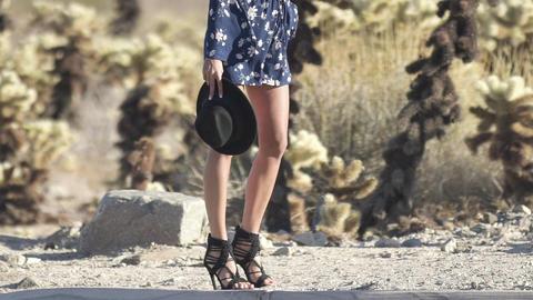girl with long legs walking in the desert GIF