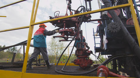 worker comes to modern geodesic equipment against wood Footage