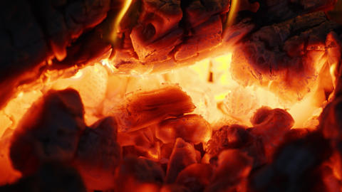 Fire sparks moving on dark at black background coming from brightly burning warm Footage