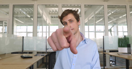 Handsome young man pointing finger at you Footage
