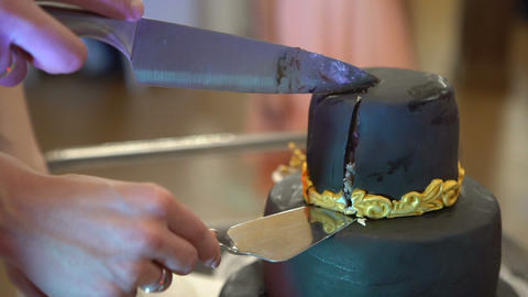 Beautiful cake cut with a knife on a stand Live Action
