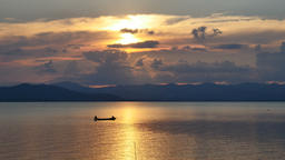 Sunset over fishing boats on reservoir, Thailand 영상물