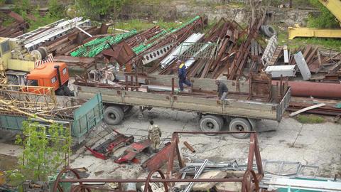 Loading of scrap metal. People working at a scrap yard Footage