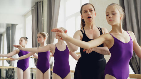 Starting ballet dancers are practising arm movements during ballet class in Footage