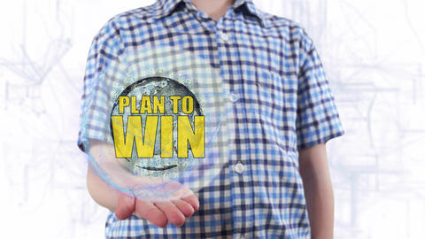 Young man shows a hologram of the planet Earth and text Plan to win Footage