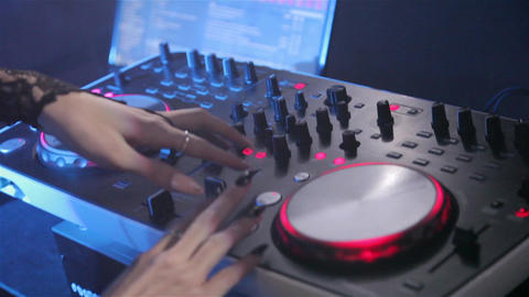 DJ plays on the remote in a nightclub. Close-up of DJ Console GIF