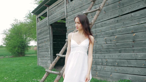 spring fashion portrait of a beautiful happy young woman in white dress with Footage