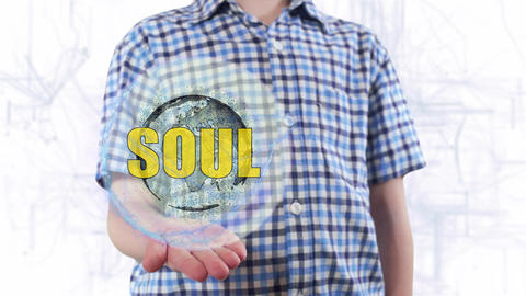 Young man shows a hologram of the planet Earth and text Soul Live Action