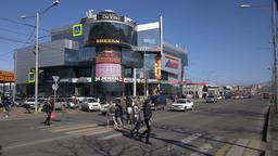 People cross the city road on pedestrian crossing Footage