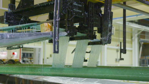 green reinforcement threads coiled on plastic pipe Live Action