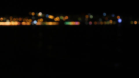Defocused night city lights in the distance ビデオ