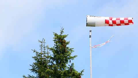 Wind vane in front of blue sky Footage