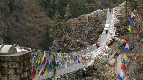 Flags Porters Suspension Bridge Travel Nepal Himalayas Mountains 4k Footage