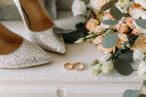 Wedding shoes and wedding paraphernalia, wedding bouquet, wedding gold rings Photo