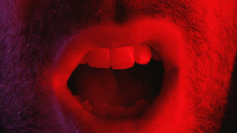 Macro closeup on man shouting with mouth wide open Footage