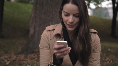 Woman laughing at text she receives on her cellular device 영상물