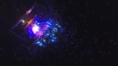 Night Aerial of people partying on the beach with dancing lights and DJ set Footage