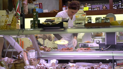 Close up shot of prosciutto ham slicing in an Italian Delicatessen shop of Italy Live-Action