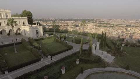Aerial of a newlywed couple kissing in a luxury villa with a view of Rome Footage