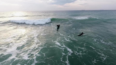 Aerial shot of a guy surfing waves in the sea Footage