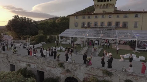 Aerial of a beautiful wedding party in a luxury Italian Villa at sunset Footage