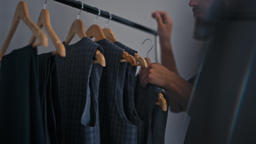 Bearded Man is Shopping Choosing a Suit on Rack in Men's Fashion Clothing Store Footage