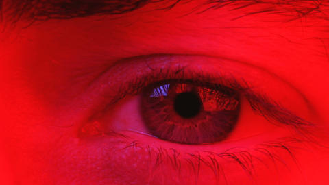 Macro on man eye expressing serious and expressionless expression Footage
