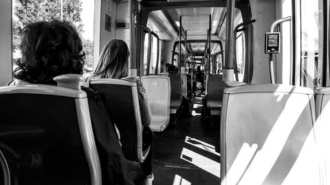 People sit in the tram, black white フォト