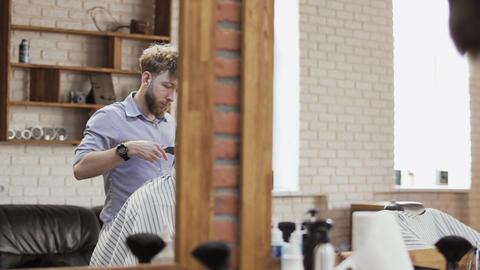 Barber works in barbershop Footage